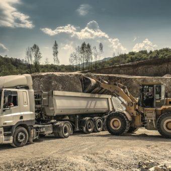 Canva - Front Load Loader Beside White Dump Truck (1)-min