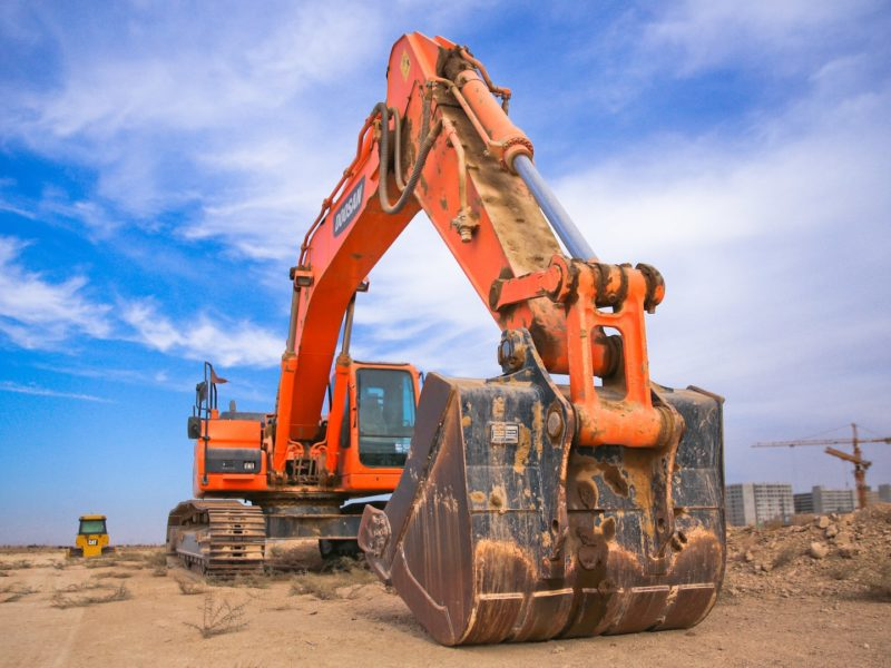Canva - Low Angle Photography of Orange Excavator Under White Clouds-min