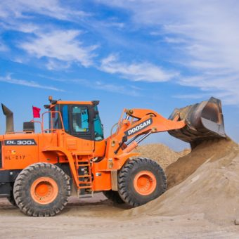 Canva - Orange Excavator on Brown Hill-min