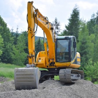 Canva - Yellow Excavator-min