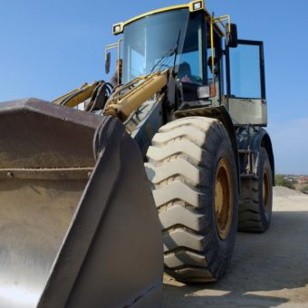 Canva - Yellow Tractor-min